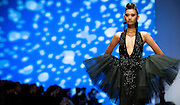 A model showcases designs on the runway by Espen Salberg on day 1 of Hong Kong Fashion Week Autumn/Winter 2013 at the Convention and Exhibition Centre on January 14, 2013 in Hong Kong, China. (Photo by Victor Fraile/Getty Images)