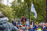 """Protesters gather and hold placards during a """"Match the Million"""" march for free speech, free assembly, and freedom from lockdowns outside Downing Street in Central London, on Saturday, Oct 10, 2020. (VXP Photo/ Vudi Xhymshiti)"""