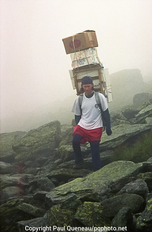 A staff member of the Appalachian Mountain Club's White Mountain hut system carries re-supplies far above timberline near Mount Washington in New Hampshire.