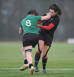 Ireland women's Claire Molloy hands off Wales women's Robyn Wilkins<br /> <br /> Photographer Mike Jones/Replay Images<br /> <br /> International Friendly - Wales women v Ireland women - Sunday 21st January 2018 - CCB Centre for Sporting Excellence - Ystrad Mynach<br /> <br /> World Copyright © Replay Images . All rights reserved. info@replayimages.co.uk - http://replayimages.co.uk