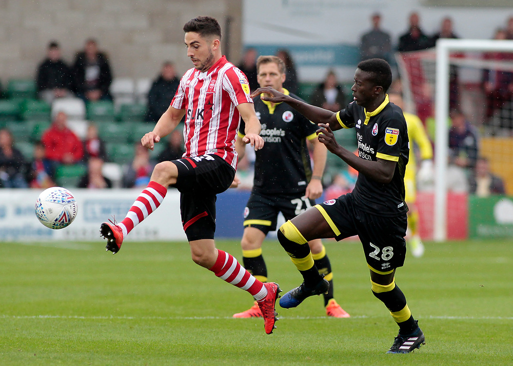 Lincoln City's Tom Pett gets away from Crawley Town's Panutche Camara<br /> <br /> Photographer David Shipman/CameraSport<br /> <br /> The EFL Sky Bet League Two - Lincoln City v Crawley Town - Saturday September 8th 2018 - Sincil Bank - Lincoln<br /> <br /> World Copyright © 2018 CameraSport. All rights reserved. 43 Linden Ave. Countesthorpe. Leicester. England. LE8 5PG - Tel: +44 (0) 116 277 4147 - admin@camerasport.com - www.camerasport.com