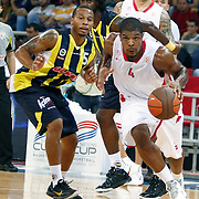 Fenerbahce Ulker's Curtis L.JERREIS (L) and Olimpiakos's Kyle HINES (R) during their Two Nations Cup basketball match Fenerbahce Ulker between Olimpiakos at Abdi Ipekci Arena in Istanbul Turkey on Saturday 01 October 2011. Photo by TURKPIX
