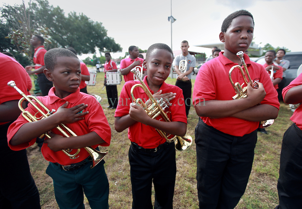 29 August 2014. Lower 9th Ward, New Orleans, Louisiana.<br /> Hurricane Katrina memorial 9 years later. <br /> L/R; Imaad Mays (10 yrs) and Sidney August (11 yrs) and Yusef Umranilz (12 yrs)from the Martin Luther King Jr Charter High School band say a prayer for victims at the official memorial in remembrance of the day Hurricane Katrina swamped the community.<br /> Photo; Charlie Varley/varleypix.com
