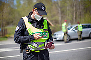The Czech border police is checking and registrating a Germany citizen before crossing the closed state border in between Germany and Czech Republic in Bayerisch Einsenstein after the corona virus outbreak changed our public lifes. Czech Republic is in the state of emergency and just their own citizens or foreigners with a residence permit are allowed to enter.