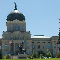 Montana state capitol building and sculpture honoring Montana hero Thomas Meagher in Helena, Montana.