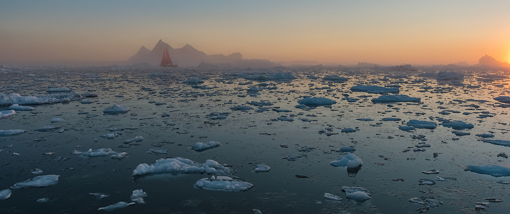 Red sails in Disko Bay. Peter the First set a new record with a round-the-world voyage through the Arctic Ocean, including both the north-east and north-west passages.