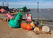 Marine navigation buoys on quayside at Felixstowe Ferry, Suffolk, England, UK