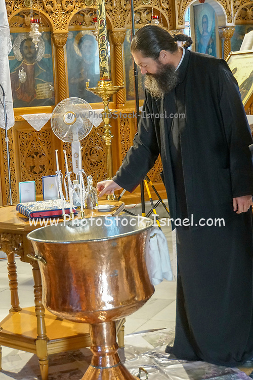 Greek Orthodox Priest performs the service in the Byzantine church in Thasos city on the Island of Thasos, Greece