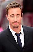 "Actor Alex O'Loughlin  poses for photographers as he arrives for the British premiere of ""The Back-Up Plan"" at Leicester Square in London, UK."