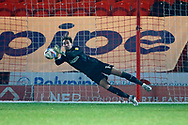 A save by Sam Walker of AFC Wimbledon  during the EFL Sky Bet League 1 match between Doncaster Rovers and AFC Wimbledon at the Keepmoat Stadium, Doncaster, England on 26 January 2021.