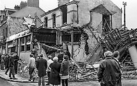 Provisional IRA explosion at the Four Step Inn on the Shankill Road, Belfast, N Ireland. Two people died and twenty seven were injured. Early morning passers-by review the wreckage. 28th September 1971, 374/71. 197109280374d<br />