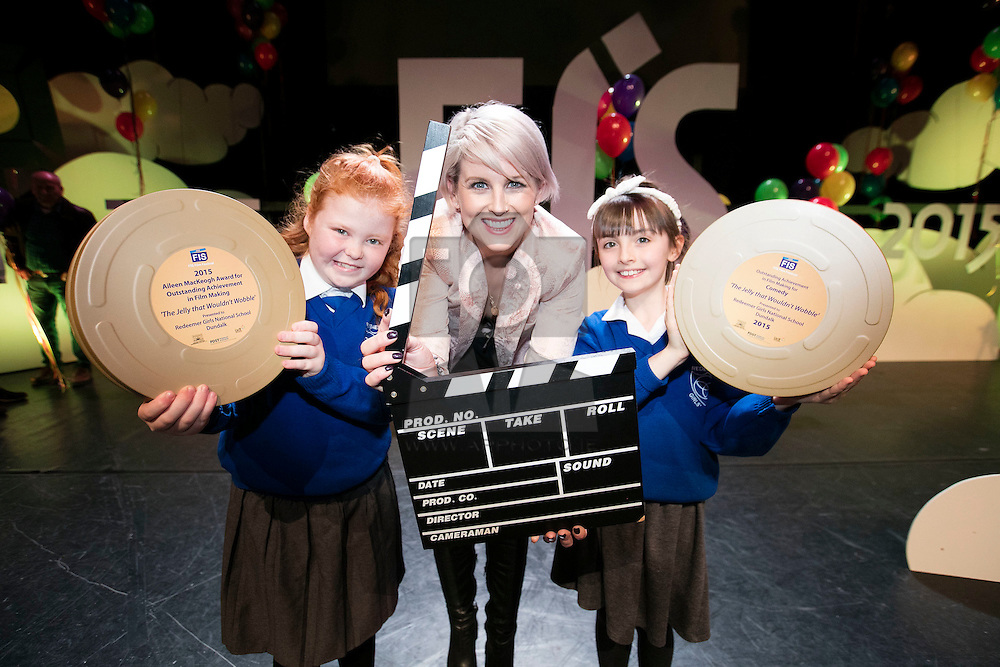"""Repro FRee: 03/11/2015 TV presenter Sinead Kennedy is pictured at the 11th FÍS Film Festival presenting Orla O'Hara and Lucy Robinson, students from Redeemer Girls NS, with the 'Aileen MacKeogh Overall Winners Award 2015' for their film """"The Jelly That Wouldn't Wobble"""", at a ceremony in the Helix, Dublin, 3 November. Picture Andres Poveda"""