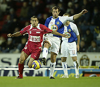 Photo: Aidan Ellis.<br /> Blackburn Rovers v AS Nancy. UEFA Cup. 13/12/2006.<br /> Rovers Lucas Neill challenges Nancy's Pascal Berenguer