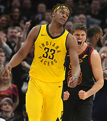 April 18, 2018 - Cleveland, OH, USA - The Cleveland Cavaliers' Kyle Korver, right, reacts after stripping the ball from the Indiana Pacers' Myles Turner (33) in the fourth quarter of Game 2 of a first-round NBA playoff series on Wednesday, April 18, 2018, at the Quicken Loans Arena in Cleveland. The Cavs won, 100-97, to even the series. (Credit Image: © Leah Klafczynski/TNS via ZUMA Wire)
