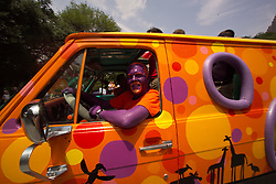 Stock photo of a painted man driving his van