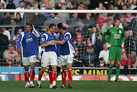 Photo: Lee Earle.<br /> Portsmouth v Manchester United. The Barclays Premiership. 07/04/2007.Portsmouth's Matthew Taylor is congratulated after scoring their second goal.