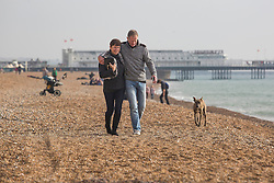 Brighton, UK. 30/10/2016, Members of the public enjoy Sunday morning on the beach in Brighton. Photo Credit: Hugo Michiels