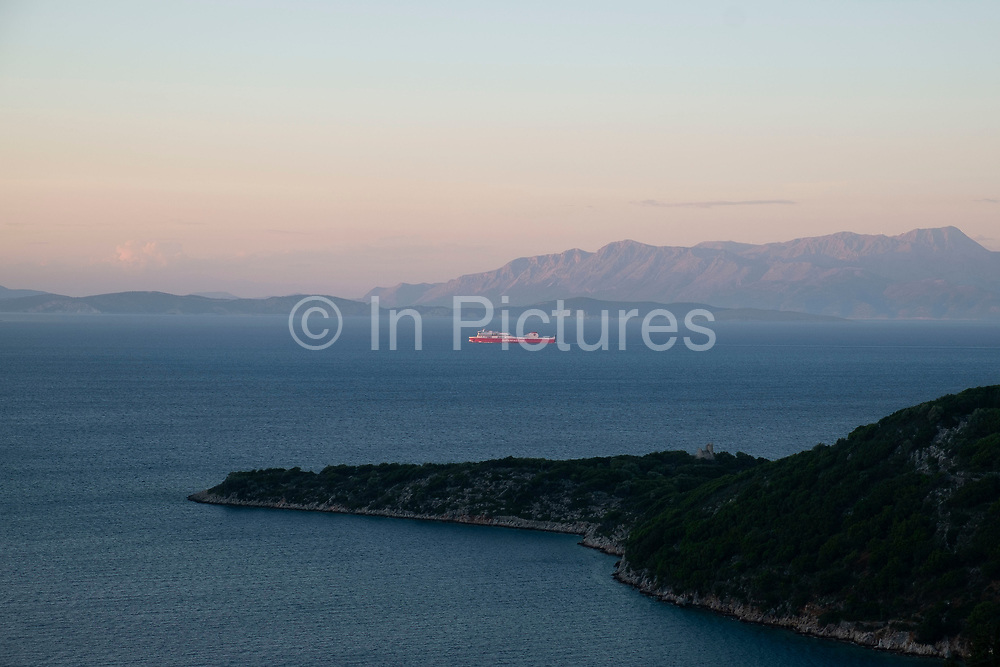 Evening view at sundown out across the Ionian Sea towards the nearby islands and mainland at Rachi, near Kioni in Ithaca Greece. Ithaca, Ithaki or Ithaka is a Greek island located in the Ionian Sea to the west of continental Greece. Ithacas main island has an area of 96 square kilometres. It is the second-smallest of seven main Ionian Islands.