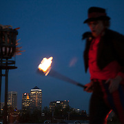 Before the lighting of the beacon two performers showed of their fire juggling skills. In the back ground is Canary Wharf.One of 4000 beacons lit across the word was lit in Tower Hamlets, London by Mayor Rahman. Tower Hamlet is one of the UK's poorest councils and also home to the financial district Canary Wharf on the Isle of Dogs.  Celebrations in London, UK for Queen Elizabeth II Diamond Jubilee. 60 years as monarch in Britain. Celebrations in London, UK for Queen Elizabeth II Diamond Jubilee.