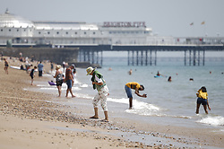 © Licensed to London News Pictures. 24/06/2021. Brighton, UK. Visitors to Brighton enjoy the warm weather on the seafront. After recent rain, a period of high temperatures and sunshine is forecast in the south. Photo credit: Peter Macdiarmid/LNP