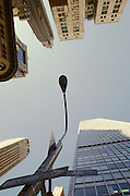 upward view of street lamp and buildings