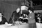 25/04/1964<br /> 04/25/1964<br /> 25 April 1964<br /> Gael Linn Secondary Schools Debating Competition final at the Shelbourne Hotel, Dublin. Proinsias Mac A'Beatha, Stuirthoir, Inniu, presenting the Sciath Inniu trophy the captain, Mairin Ni Chonchubhair,  of the Colaiste Ide, Daingean (Dingle), Co. Kerry team,  who won the team award.