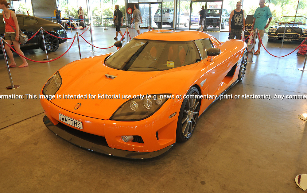 2006 Koenigsegg CCX - Competition Coupé X - Lava Orange.Topgear Live Festival .The Melbourne Showgrounds .Flemington. Melbourne, Victoria.13th March 2011.At the heart of the Festival will be a 1.52km, purpose-built track which will weave through the streets and buildings of the showground precinct..The Top Gear Live track, the first ever to be constructed in Australia, will play host to over 120 of the country's best drivers as they take part in a spirited competition to set the fastest Top Gear Live lap..With over 20 corners, ranging from the tight and technical 'Woodchop' and 'Town Square', to the fast and furious 'Power Arena', spectators will have unprecedented access plus the opportunity to get up close with drivers and cars, as well as checking out all the action. Cars likely to be on the track range from the likes of V8 Supercars, multiple Bathurst's 12hr class winners, prototype race cars, historic and modern tarmac rally cars, V8 muscle cars and historic open wheel racing cars..(C) Joel Strickland Photographics.Use information: This image is intended for Editorial use only (e.g. news or commentary, print or electronic). Any commercial or promotional use requires additional clearance.