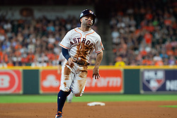 May 23, 2018 - Houston, TX, U.S. - HOUSTON, TX - MAY 23: Houston Astros second baseman Jose Altuve (27) runs passed third base scoring on Houston Astros shortstop Carlos Correa (1) single in the fifth inning during MLB baseball game between the Houston Astros and the San Francisco Giants on May 23, 2018 at Minute Maid Park in Houston, Texas. (Photo by Juan DeLeon/Icon Sportswire) (Credit Image: © Juan Deleon/Icon SMI via ZUMA Press)