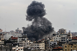 May 5, 2019 - Gaza City, Gaza Strip - Israeli aircrafts target a building of the Islamic resistance movement, Hamas, on the west of Gaza City. The airstrikes are part of an Israeli aerial offensive on the Gaza strip on both Saturday and Sunday that targeted military and civilian buildings and which began after the launch of dozens of rockets from Gaza into Israel on Saturday morning (Credit Image: © Ahmad Hasaballah/IMAGESLIVE via ZUMA Wire)