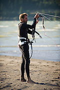 Fernando Gomez. a Mexican national, untangles his lines as he prepares to launch his kite at Hood River, Oregon