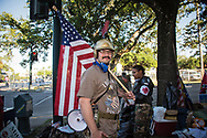 Protester across from the  Jefferson Davis Monument in New Orleans. The monument is one of four that the city will take down.