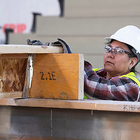 Charity Eriacho guides a floor beam so it can be nailed into place creating a subfloor Tuesday afternoon at Greater Gallup Economic Development Corporation's workforce program in Gallup.