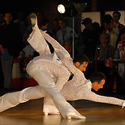 A couple competes in the senior men's latin division of the same-sex ballroom dancing competition during the 2007 Eurogames at the Waagnatie hangar in Antwerp, Belgium on July 13, 2007. ..Over 3,000 LGBT athletes competed in 11 sports, including same-sex dance, during the 11th annual European gay sporting event. Same-sex ballroom is a growing sports that has been happening in Europe for over two decades.