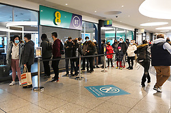 © Licensed to London News Pictures. 07/03/2021. London, UK. Customers queue inside the Ealing Broadway Shopping Center to enter the first AMAZON GO grocery store in the UK. The grocery store opened earlier this week and features contactless payment via the AMAZON app. Shoppers need to use app to shop inside the store and pick up groceries without stopping to pay. Photo credit: Ray Tang/LNP