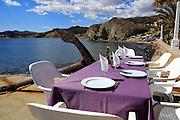 Waterside restaurant table, Isleta de Moro village, Cabo de Gata natural park, Nijar, Almeria, Spain