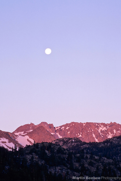 A full moon rises over Mt. Lamarck in the Eastern Sierra Nevada, Inyo National Forest, California
