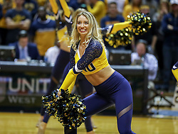 Nov 24, 2018; Morgantown, WV, USA; A West Virginia Mountaineers dancer performs during the first half against the Valparaiso Crusaders at WVU Coliseum. Mandatory Credit: Ben Queen-USA TODAY Sports