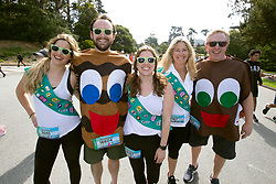 A trio of Girl Scouts (and their cookies) pose for a photograph in Golden Gate Park at the 107th running of the Bay to Breakers, Sunday, May 20, 2018, in San Francisco. (Photo by D. Ross Cameron)