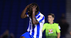 Brighton & Hove Albion's Elvis Manu looks dejected after a missed chance on goal