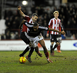 Bristol City's Tyrone Barnett passes Brentford's Kevin O'Connor - Photo mandatory by-line: Dougie Allward/JMP - Tel: Mobile: 07966 386802 28/01/2014 - SPORT - FOOTBALL - Griffin Park - Brentford - Brentford v Bristol City - Sky Bet League One