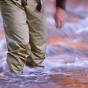 Brennen Fitzgerald drags his fly line at sunset on the Eagle River in Eagle Colorado.