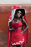 A Mexican women dressed as La Calavera Catrina during the Day of the Dead or Día de Muertos festival October 31, 2017 in Patzcuaro, Michoacan, Mexico. The festival has been celebrated since the Aztec empire celebrates ancestors and deceased loved ones.