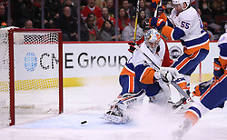 March 3, 2017 - Chicago, IL, USA - New York Islanders goalie Thomas Greiss (1) blocks away a shot by the Chicago Blackhawks in the first period of a game at the United Center on Friday, March 3, 2017 in Chicago, IL. (Credit Image: © Chris Sweda/TNS via ZUMA Wire)