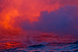 Lava flows into the Pacafic Ocean on the Puna Coast, Volcanoes National Park, Hawaii