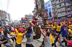April 30, 2017 - Kathmandu, NP, Nepal - The Local leader on the chariot leads to pull Chariot of Rato Machindranath 'God of Rain' on first day at Pulchowk, Lalitpur, Nepal on Sunday, April 30, 2017. The longest festival of Nepal, Rato Machindranath Festival continues from May 10, 2016. Rato Machindranath is also said as the 'god of rain' and both Hindus and Buddhists worship the Machindranath in hope of good rain to prevent drought during the rice plantation season. (Credit Image: © Narayan Maharjan/NurPhoto via ZUMA Press)