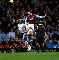 Photo: Dave Linney.<br />Aston Villa v Bolton Wanderers. The Barclays Premiership. 16/12/2006. Villa's Chris Sutton(R) beats  Abdoulaye<br />Faye to the ball.