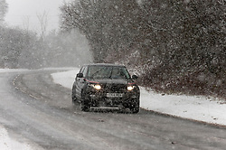 © Licensed to London News Pictures. 29/12/2020. Llanfihangel Nant Melan, Powys, Wales, UK. Motorists drive through winter weather on the A44 road near Llanfihangel Nant Melan in Powys, Wales, UK. Photo credit: Graham M. Lawrence/LNP