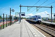 Treinstation met parkeerplaats voor auto's bij Sassenheim - Trainstation with parking for cars near Sassenheim, The Netherlands