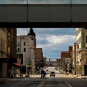 Two people cross a nearly empty Jefferson Avenue in Toledo on Monday, April 13, 2020. THE BLADE/KURT STEISS