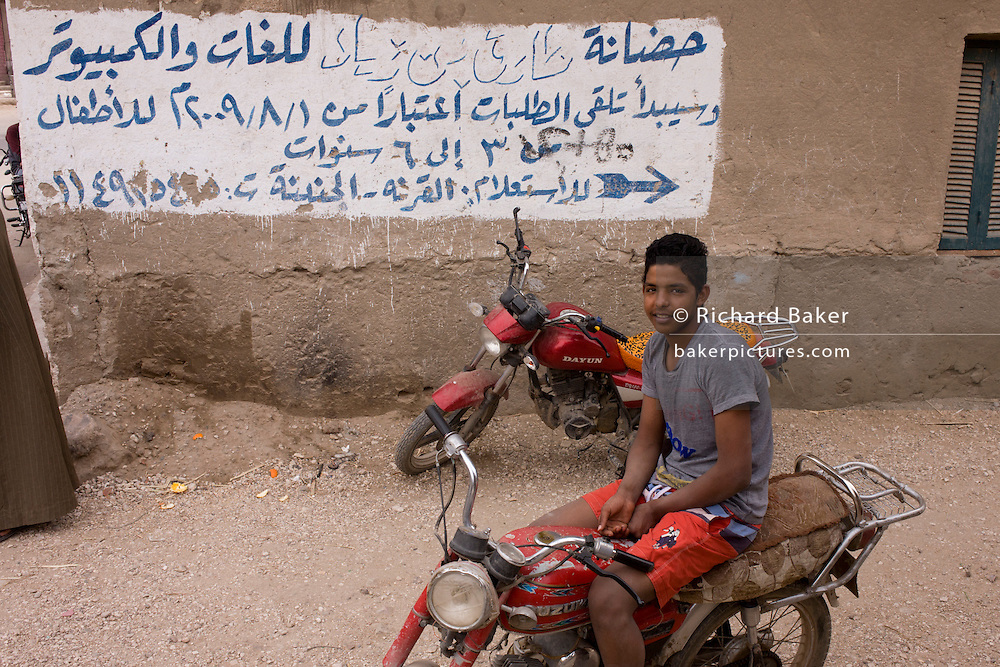 Portrait of a local youth on his motorbike in Qurna, a village on the West Bank of Luxor, Nile Valley, Egypt.